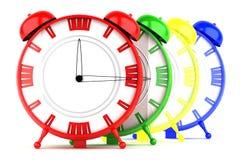 Kulöra klockor som isoleras på vit bakgrund Royaltyfri Bild