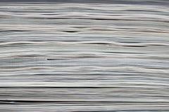 kulöra papperen staplad textur Arkivbild