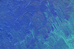 Kulöra penseldrag av blå olje- målarfärg på kanfas Royaltyfri Foto