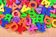 Kulöra plast- alfabetbokstäver Fotografering för Bildbyråer