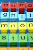 Kulöra plast- bokstäver av abc:et Arkivbild