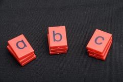 Kulöra plast- bokstäver av abc:et Fotografering för Bildbyråer