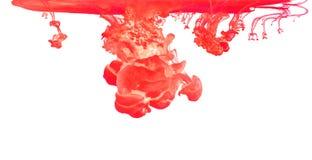 Kulört färgpulver i vatten som skapar abstrakt form Royaltyfri Bild