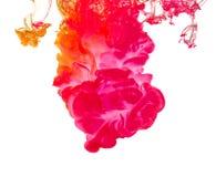 Kulört färgpulver i vatten som skapar abstrakt form Royaltyfria Foton