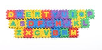 kulört mång- pussel för alfabet fotografering för bildbyråer