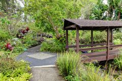 Kula Botanical Garden. Maui. Hawaii. Covered bridge. Tropical landscape. Royalty Free Stock Photo