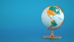 Kula ziemska z geographical mapą na błękitnym tle Zdjęcia Royalty Free