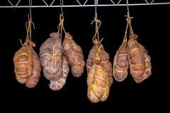 Kulen hanging in smokehouse stock photos