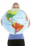 kuli ziemskiej mienia kobieta Zdjęcia Royalty Free