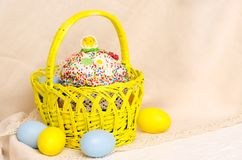 Kulich cake with easter decoration and colored eggs Stock Photo