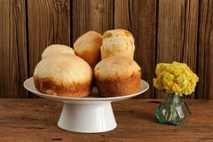 Kulich, Russian easter yeast sweet breads on white pedestal with Stock Image