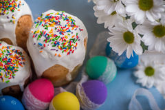 Kulich, traditional Russian Ukrainian Easter cake with colored eggs and flowers Royalty Free Stock Photography