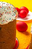 Russian Easter cake. Kulichi, traditional Russian Easter cake with icing and dyed eggs stock photo