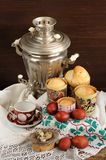 Kulichi, traditional Russian easter cakes with samovar, dyed egg Stock Images