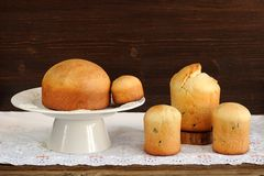 Kulichi, traditional Russian easter cakes on white pedestal on w Royalty Free Stock Photos