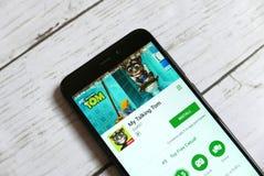 KULIM, MALASIA - 11 DE ABRIL DE 2018: Mi uso de Tom que habla en una tienda del juego de Google del androide Fotos de archivo libres de regalías