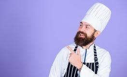 Kulinarisk expert Matlagning är min passion bästa kock någonsin Perfekt kock med proper blick Yrkesmässig kock i likformig royaltyfria foton