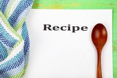 Kulinariskt recept, handduk och sked royaltyfri fotografi