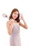 Kulinarna kobieta daje ok ręka znakowi ty, biel odizolowywający Zdjęcie Stock