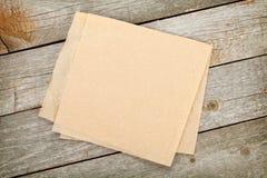 Kulinarny papier nad drewnianym stołem obraz stock