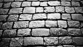 Kullersten på trottoaren i den gamla staden lager videofilmer