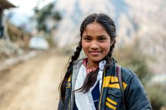 Kullu, Himachal Pradesh, India - March 01, 2019 : Portrait of himalayan girl in himalayas stock image