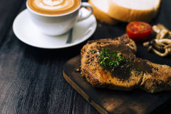 Kulobuta steak with coffee and bread royalty free stock photos