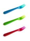 Kulöra plast-gafflar Fotografering för Bildbyråer