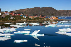 Kulusuk, a small village in Greenland. Picture taken in the summer. Kulusuk is a quiet village in  East Greenland, surrounded by icebergs Stock Photo
