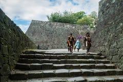 Kumamoto castle. KUMAMOTO, JAPAN - SEPTEMBER 27, 2014: People dressed as ancient Samurai at Kumamoto castle in Kumamoto, Japan. Kumamoto Castle is a hilltop Royalty Free Stock Photo