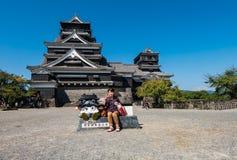 Kumamoto castle. KUMAMOTO, JAPAN - SEPTEMBER 27, 2014: Tourists around Kumamoto castle in Kumamoto, Japan. Kumamoto Castle is a hilltop Japanese castle located Royalty Free Stock Photo