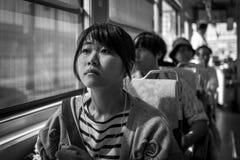 Kumamoto, Japan - May 13: Young girls sits in tram on May 13, 2017 in Kumamoto, Japan. stock photos