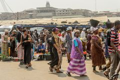Unidentified Ghanaian people walk at the Kumasi market. royalty free stock image