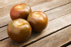 Kumato or Brown Tomato Stock Images