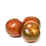 Kumato tomatoes Stock Images