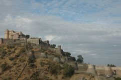Kumbhalgarh Fort as seen from the nearby village, India. Kumbhalgarh `Kumbhal fort` is a Mewar fortress on the westerly range of Aravalli Hills, in the Rajsamand Stock Image