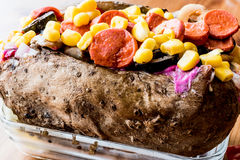 Kumpir / Turkish Baked potato with cheese, corn and sausage Stock Images