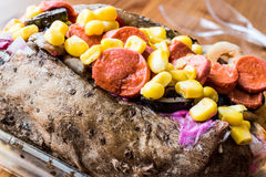 Kumpir / Turkish Baked potato with cheese, corn and sausage Royalty Free Stock Image
