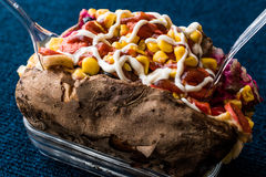 Kumpir / Turkish Baked potato with cheese, corn, sausage, ketchup and mayonnaise Royalty Free Stock Image