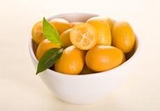 Kumquat. Small orange fruits on white background Stock Photography