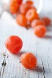Kumquat dried. On a white wooden desk Stock Photos