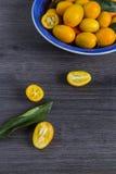 Kumquat fruit in a blue bowl Stock Photo