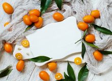 Kumquat fruits on a grey background. Top view stock photo