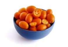 Kumquat fruits on a white background. Kumquat fruits in a bowl on a white background royalty free stock photography
