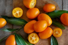 Kumquat fruits on a wooden background. Top view royalty free stock photos