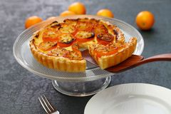 Kumquat tart, homemade dessert. Kumquat, its raw rind is sweet, with the flesh is sour like the lemon stock images