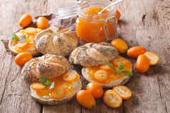 Kumquat jam in a glass jar and sweet sandwiches close-up. horizo Royalty Free Stock Image
