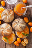 Kumquat jam in a glass jar and sweet sandwiches close-up on the Stock Photo
