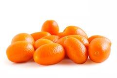 Kumquat juteux frais sur le fond blanc Photos stock