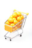 Kumquat in shopping cart Royalty Free Stock Images